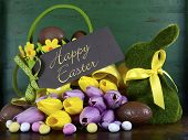 picture of bunny rabbit  - Happy Easter green moss grass bunny rabbit with basket of chocolate eggs and spring tulips against a green wood background - JPG
