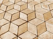stock photo of paving stone  - Urban road is paved with blocks of stone cobblestone walkway sepia - JPG
