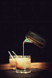 picture of marsala  - Preparation of white russian cocktails on the bar counter on rubber mat - JPG