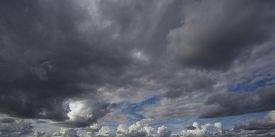 stock photo of blue  - panorama of white and gray clouds against the blue sky - JPG
