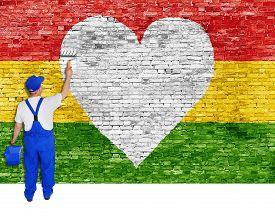 image of reggae  - House painter paints heart symbol and flag of Reggae music - JPG