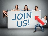 stock photo of joining  - Join us word writing on white banner - JPG