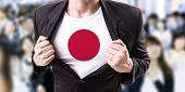picture of japanese flag  - Businessman stretching suit with Japanese Flag with a crowd people on background - JPG