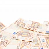 picture of fifties  - Surface covered with multiple fifty euro bank notes isolated over the white background - JPG