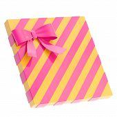 picture of gift wrapped  - Wrapped yellow  gift box with a purple magenta bow and ribbon isolated over white background - JPG