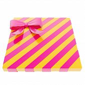 pic of gift wrapped  - Wrapped yellow  gift box with a purple magenta bow and ribbon isolated over white background - JPG