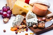pic of dry fruit  - Cheeses with dried fruits and nuts on wooden board - JPG