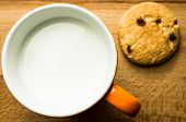 stock photo of baked raisin cookies  - Shortbread cookies with raisins and a glass of milk - JPG