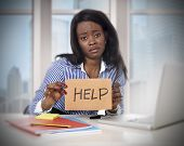 pic of frustrated  - black African American ethnicity tired and frustrated woman working as secretary in stress at work business district office desk with computer laptop asking for help in frustration concept - JPG