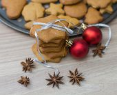 stock photo of christmas cookie  - Christmas Gingerbread Cookies homemade on wooden table - JPG