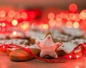 stock photo of christmas cookie  - Christmas Gingerbread Cookies homemade on wooden table with decoration holidays light  - JPG