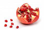 image of pomegranate  - Ripe pomegranate fruit and pomegranate seeds isolated on white background - JPG