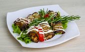foto of aubergines  - Aubergine roll with cheese and walnut served tomato salad rosemary - JPG