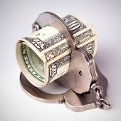 image of punishment  - economic crime the punishment of the offender dollars in handcuffs square image DSLR photography finance and law moneys of the United States - JPG