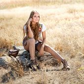 foto of tallgrass  - Hippie girl sitting on a tree stump  - JPG