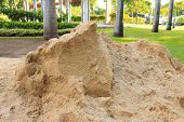 picture of sand gravel  - Pile of sand in public outdoor park - JPG