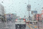 stock photo of flood-lights  - Water drop on traffic jam and electric light in the rain - JPG