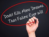 image of kill  - Man Hand writing Doubt Kills More Dreams Than Failure Ever Will with black marker on visual screen - JPG