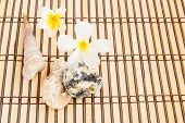 pic of stone-therapy  - Tropical Plumeria and stone therapy on bamboo mat for spa and wellness concept - JPG