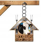 foto of food chain  - Wooden and metallic sign in the shape of house with text Steak House head of cow two forks - JPG