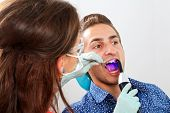stock photo of gingivitis  - The dentist is filling the patient - JPG