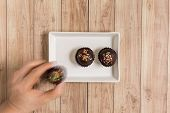 pic of cake-ball  - Fresh chocolate ball cakes sprinkled with colorful sugar balls - JPG