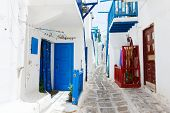image of greek-island  - Typical greek traditional village with white walls and colorful doors - JPG