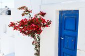stock photo of greek-island  - Typical greek traditional village with white walls and colorful doors - JPG