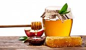 image of honeycomb  - Glass cans full of honey - JPG