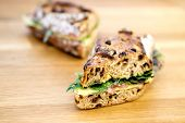 pic of deli  - A delicious rustic deli sandwich on a wooden table