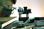 picture of rifle  - young man aiming a pneumatic air rifle  - JPG