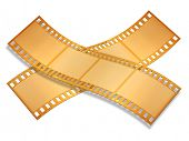 two crossed gold film strip isolated on white