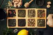 Assortment of dry tea. Tea composition with different kind of tea. Tea concept. poster