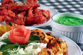tandoori fish and chicken tikka in plates