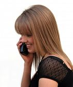 Beautiful blond girl talking on the phone.