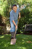 Handsome man with shovel