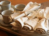 Tea cups and napkins at the bistro.