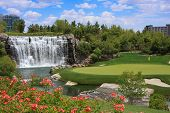 Beautiful golf course and waterfall.