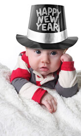 foto of new years baby  - Happy New year baby wearing a top hat - JPG