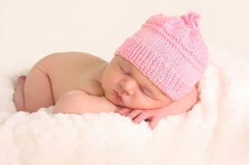 stock photo of newborn baby girl  - Newborn baby girl in a knitted hat - JPG