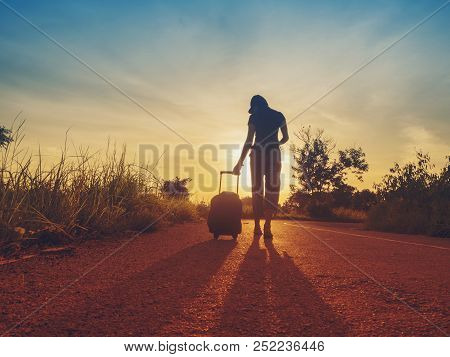 poster of Traveling Girls Are Traveling With Luggage. Through Nature Tourism. (travel Ideas)