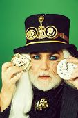 Senior Man Bearded Male Or Watchmaker With Blue Lenses In Eyes And White Beard Hair In Black Hat Wit poster