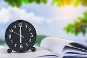 Holding Clock On Sea Blurred Background The Time 6:00 Am Or Pm And Noon Or Midnight For Made Clock I poster