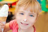 children girl happy with cone ice cream smiling