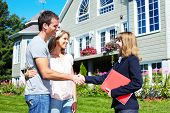 pic of real-estate agent  - Happy family with agent realtor near new house - JPG