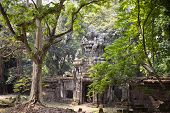 Ancient Ruins Of Angkor Thom Temple In Angkor Wat Complex, Cambodia. Angkor Thom Wall And Gate In Fo poster