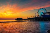 Visitors Enjoy Scenic Sunset Above Santa Monica Pier In Los Angeles, California. poster