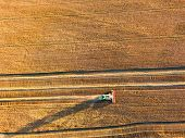 Harvester Machine Working In Field. poster