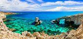 Beautiful nature and  cystal clear waters of Cyprus island. arch bridge near Agia napa calls bridge poster