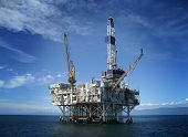stock photo of crude-oil  - Large Pacific Ocean oil rig drilling platform off the southern coast of California - JPG